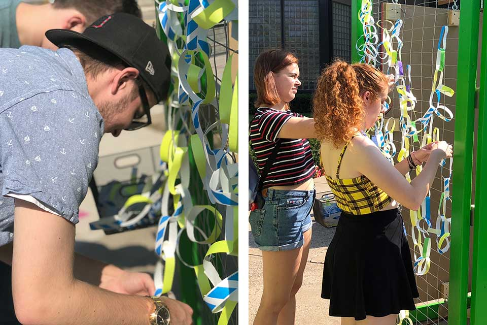 Visitors adding ribbons to Broken Wings installation