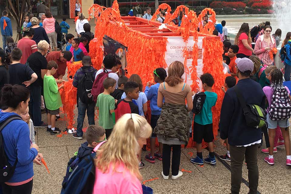 Visitors interacting with Color Me Orange—Color Me Kind during ArtPrize Eight