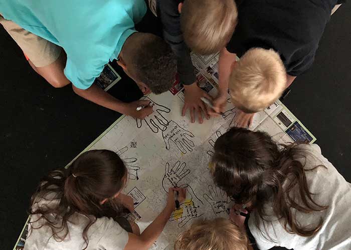 Elementary students in Denver doing hand trace drawings