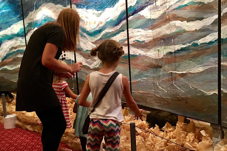 ArtPrize Nine visitors interact with Let Go