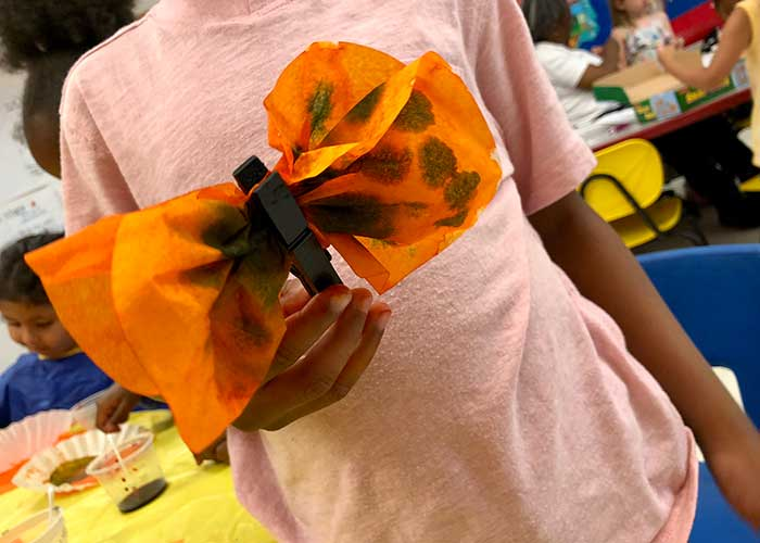Elementary students participate in healing art by crafting butterflies