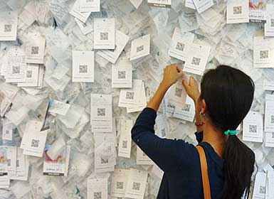 Hanging cards on Wall of Hope with over 20,000 already used up
