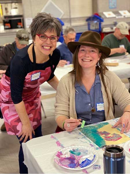 Veterans and families during workshops creating art for Yellow Ribbon installation